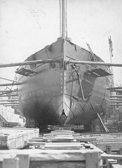 USS Intrepid bow view, taken in dry dock, circa the 1870s. Note the torpedo projection device at her forefoot, pattern of her hull plating and the anchor hanging from her port hause pipe. (U.S. Naval Historical Center Photograph)