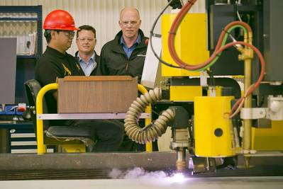 (left to right) Vancouver Shipyard's Chester Saret - Burning Area Chargehand, Brian Carter – President, Seaspan Shipyards, and Mike Corrigan – President & CEO, BC Ferries, oversee the first cut of steel on the new BCFS Cable Ferry.