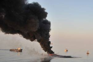 Vessels conduct controlled burns that are part of a coordinated federal, state and local effort to minimize the amount of oil in the water near the Deepwater Horizon oil spill site in the Gulf of Mexico, Sunday, June 13, 2010. More than 165 controlled burns have been conducted, removing a total of more than 3.85 million gallons of oil from the open water. (Coast Guard photo by Lt. Cmdr. Paul Rooney)