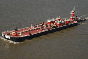 Bouchard's B. No. 264 and tug Evening Tide navigate down the Mississippi River delivering the barge's first load of cargo. Photo courtesy Bollinger Marine Fabricators, L.L.C.