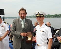 Ensign Jeffrey Iiams receives the Elmer A. Sperry Junior Navigator of the Year Award from Jeff Holloway of Northrop Grumman Corporation.