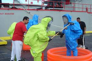 Qatar firefighters learn decontamination techniques at RESOLVE Maritime Academy. Photo courtesy Resolve Marine
