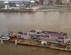 Jeff Ruby's Waterfront restaurant and barge being pushed back upriver by C&B Marine towboats. Photo courtesy C&B Marine.