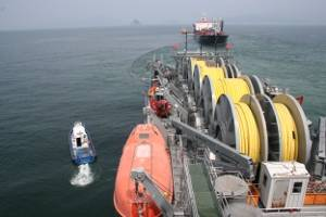 In 2009, the Military Sealift Command offshore petroleum distribution system ship MV Vice Adm. K.R. Wheeler (foreground) and Military Sealift Command tanker USNS Lawrence H. Gianella (background) practice running a float hose between the two ships during a one-day exercise off the coast of Yeosu, South Korea. (U.S. Navy photo by Edward Baxter, taken off Yeosu, South Korea on Aug. 18, 2009)