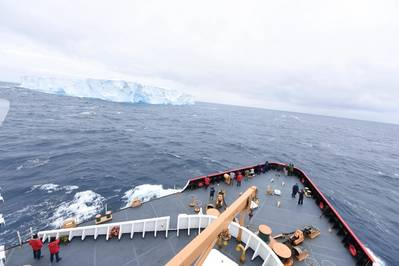 Passengers and the crew of CGC Polar Star gather to observe their first encounter with ice during Operation Deep Freeze 2016 in the Southern Ocean Jan. 3, 2016. (U.S. Coast Guard photo by Grant DeVuyst)