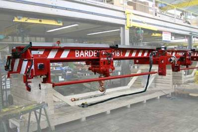 A hydraulically operated overhead crane with a hoist lift capacity of 18 tons, manufactured by J D Neuhaus for Bardex Corporation