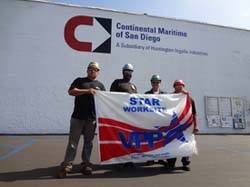 """CMSD employees (left to right) Antonio Larrios Jr., Leander Hill, Robert Cooley and Anita Garcia display the VPP flag that was presented when the work site was awarded """"star"""" status by OSHA."""