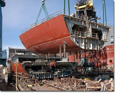 A section of the hull of the USNS Medgar Evers (T-AKE 13) lowered into place in January of 2011.