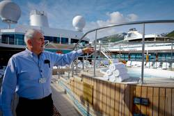 A Crowley Ocean Ranger observes the state of a cruise ship pool deck