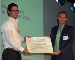 Bas Borsje (left) receives the IADC Award for the Best Paper by a Young Author from IADC Secretary General René Kolman at CEDA Dredging Days, November 11, 2011.