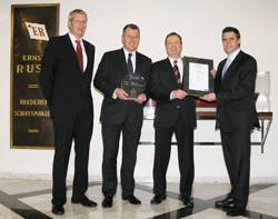 "(from left to right): Dirk Lange, Germanischer Lloyd, Stefan Bülow, Reederei Ernst Russ, Jan Stahmer, Reederei Ernst Russ, and Matthias Ritters, Germanischer Lloyd, at the presentation of the ""GL Excellence - 5 Stars"" Certificate."