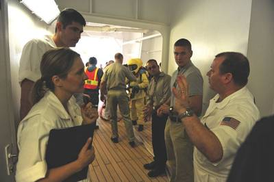 Scott Elphison, senior marine inspector for the Coast Guard Cruise Ship National Center of Expertise, addresses students and fellow instructors in a cruise ship inspection on Oct. 31, 2009. The lesson was part of an Advanced Foreign Passenger Vessel Examination course.