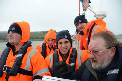 """Putting their seamanship training to the test onboard the """"Fairtide"""" from Offshore Marine Academy are (from left) Joe Stafford, Ralph Williams, Martyn Berrington and Scott Pitman with their tutor from the University, Andrew Eccleston."""