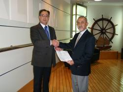 Captain Deepak Honawar, Wallem's director of safety and quality, and Kaveh Mansoorian, DNV Senior Customer Service Manager, sign the contract in Hong Kong.