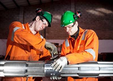 Onshore Technician, Lewis Brake (L) and Ian Spence, Onshore Supervisor (R) working on a Coretrax SP superior performance magnet.