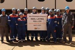 Apprentices, officials at ceremony: Photo credit Aker