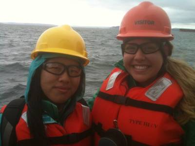 Scholarship winners Ariel Zhou (left) and Caiti Campbell (right) aboard Crolwey's tug, Guardsman