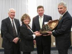 Kris Carroll Receives the Award: Photo credit Center for Coastal Conservation