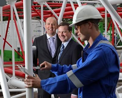 EnerMech managing director Doug Duguid and UK Manager Stuart Smith observe crane technician Ryan Nicol working on a crane boom.