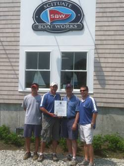 Massachusetts State Representative Jim Cantwell was among the dignitaries attending the recent grand opening of the new Scituate Boat Works (SBW) marine services building and Ship's Store. Left to right: SBW Vice President Scott Hamernick; SBW President Brian Curreri; Rep. Cantwell; and SBW Vice President Marc Curreri.