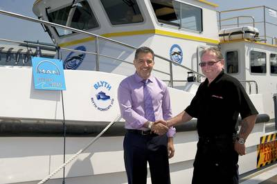 Wildcat Marine Co-Owner Dr Omar Namor (left) Receives Their Blyth 17 From Ray Chuter, Blyth Workcats' Production Director