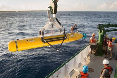 The team aboard the K-O-K research vessel prepare the Bluefin Robotics AUV for deployment. The vehicle was equipped with a Ranger 2 tracking transponder, visible towards the rear of the AUV