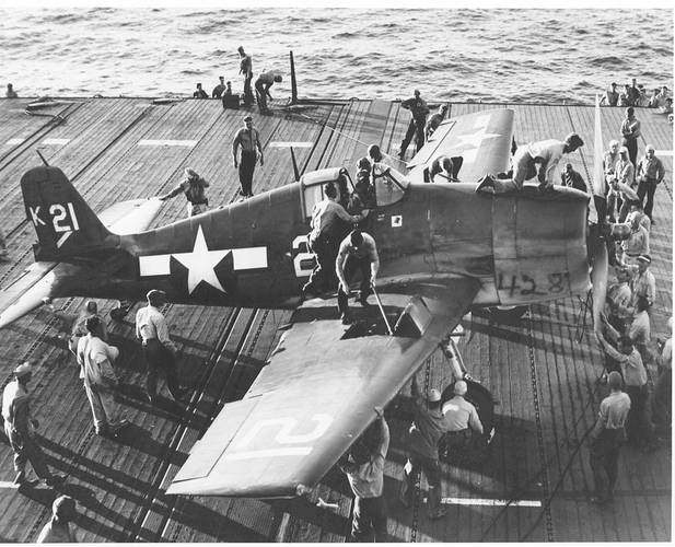 Flight Deck Crew Swarm Over an F6F Hellcat - July 1944. (Photo: U.S. Navy's National Museum of Naval Aviation, Pensacola, Fla.)