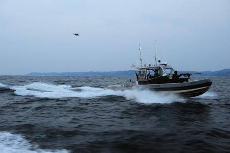 A boat crew from U.S. Coast Guard Port Security Unit (PSU) 313, from Everett, Wash., conducts a security patrol in a 4th generation, 32-foot transportable security boat (TSB) off the coast of Dogu beach in support of exercise Foal Eagle, April 21, 2013. This is the first time since 2006 that a Coast Guard PSU has participated in Korean Theater of Operations (KTO). (U.S. Coast Guard photo by Petty Officer 2nd Class Etta Smith/Released)