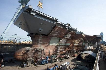 The flight deck of the aircraft carrier Gerald R. Ford (CVN 78) was completed on April 9, 2013, with the addition of the upper bow. The bow weighs 787 metric tons and brings Ford to 96 percent structural completion. Photo courtesy of Huntingdon Ingalls Industries.