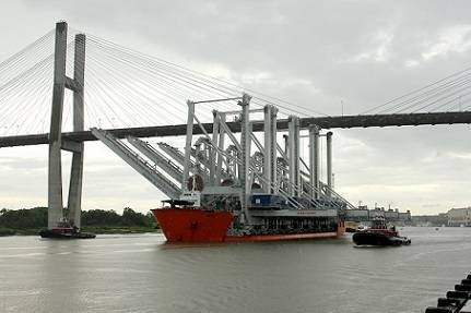 Four new super post-Panamax ship-to-shore cranes navigate the Savannah River channel on their way to the Port of Savannah's Garden City Terminal on Wednesday, June 5. (Russ Bryant/Georgia Ports Authority)