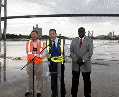 In a news conference, Georgia Ports Authority Executive Director Curtis Foltz, center,  joined by Ricky DeLoach, left, president of Local #1475 Clerks and Checkers Union, and Willie Seymore, president of Local #1414 Longshoremen's Union, both affiliates of the International Longshoremen's Association.