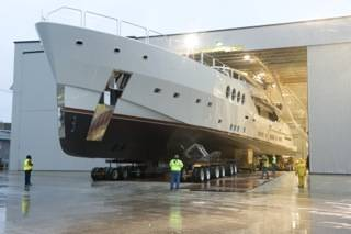 After a trek that often involved steering with only inches of clearance and a complex 90-degree turn, Chris Holland, president of HMR Supplies, moves this new 215-foot, 480-ton superyacht out of the fabrication facility and to the barge for its initial launch and sea trials.