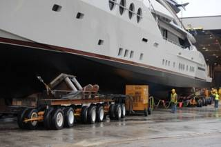 A skilled team of engineers from HMR Supplies designed the bolster and dolly systems used to move this 215-foot, 480-ton superyacht from its fabrication facility to open water.