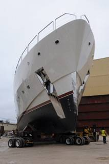 A complex 90-degree turn on the superyacht's trek from fabrication facility to open water would not have been possible without Powered Holland Dollies moving the front of this small oceanliner independently from its back. The dollies are run hydrostatically and by remote control.