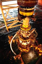 The Deepwater Horizon rig's damaged Blow Out Preventer (BOP), along with the Lower Marine Riser Package (LMRP) Cap, being removed from the Gulf of Mexico.  (Photo credit: PO1 Thomas Blue, U.S. Coast Guard)
