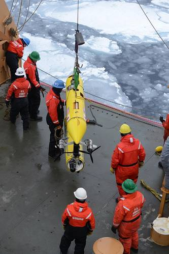 Coast Guard Cutter Healy deckhands prepare to lower an unmanned underwater vehicle, operated by the Woods Hole Oceanographic Institute, into the Beaufort Sea. WHOI scientists used the UUV to monitor ice conditions from below during the simulated exercise. (U.S. Coast Guard photo by Petty Officer 3rd Class Grant DeVuyst)