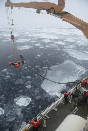 Members of the Coast Guard Cutter Healy deck department lower an oil skimmer into the ice-laden Beaufort Sea. Multiple Coast Guard units and partner agencies and organizations, coordinated by the Coast Guard Research and Development Center, cooperated to accomplish the exercise, which explored the potential for present technology to respond to an oil spill in the extreme Arctic environment. (U.S. Coast Guard photo by Petty Officer 3rd Class Grant DeVuyst)