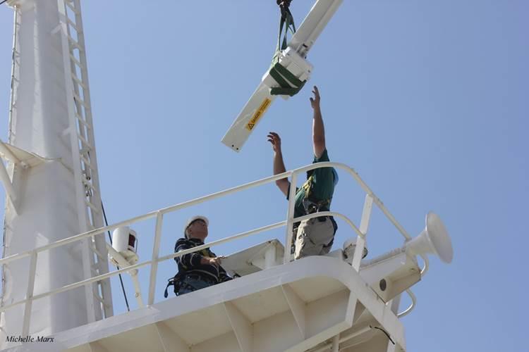 Installing a new Kelvin Hughes Ltd Manta Digital Radar unit  onboard the Africa Mercy. (© Mercy Ships/Michelle Marx)