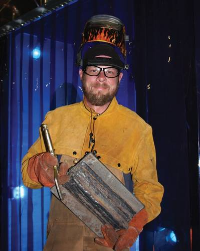 Student Josh Lanser displaying his recent welding project.