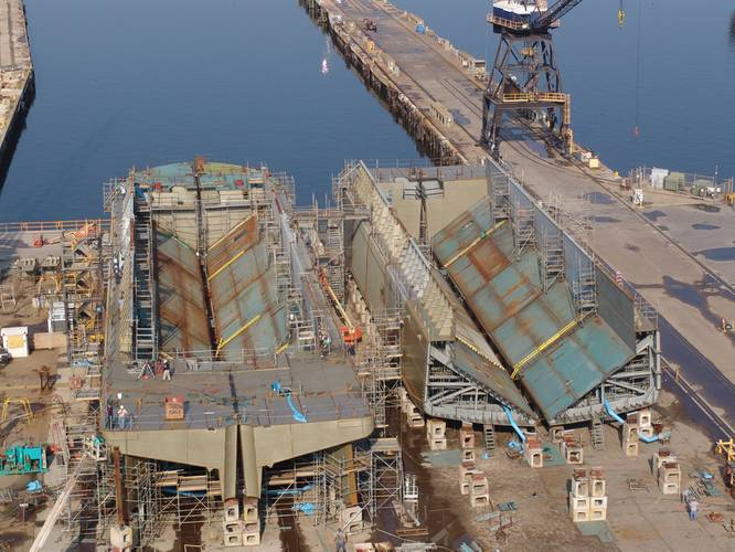 Two dump scows for Great Lakes Dredge & Dock Company  under construction in Mobile.