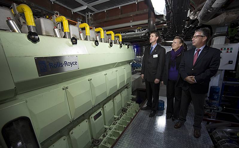 Inside the engine room, the Rolls-Royce team admire the Bergen gas engine> Project Manager Oscar Kallerdahl, Aila Lainio from our Rauma site where the thrusters are manufactured, and Ruediger Dube, VP Merchant, Europe, Middle East and Africa.