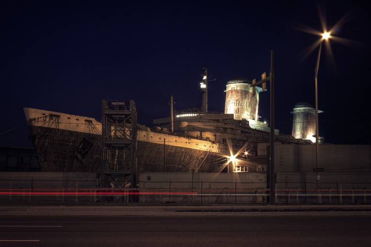 """The funnels, bridge, and radar mast of the SS United States lit for the Conservancy's """"National Flagship Celebration"""", July 1, 2010. The light installation was done by artist Robert Wogan. (Credit: SS United States Conservancy)"""
