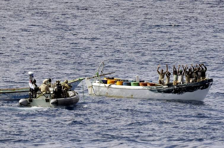 HMAS Melbourne's boarding party intercepts a suspected pirate boat. (Photo: ABIS Jayson Tufrey)