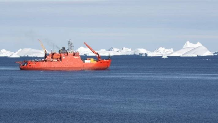 The Aurora Australis two kilometers off station on a clear sunny day at resupply (Photo: Colin)