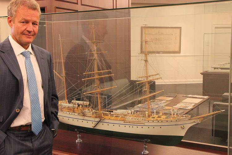 Shipyard boss Dr. Herbert Aly in Front of the German Navy sail training ship Gorch Fock where he was a crew member during his naval service.