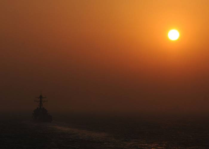 STRAIT OF HORMUZ (Oct. 12, 2012) The guided-missile destroyer USS Jason Dunham (DDG 109) is underway in the Strait of Hormuz at sunset, while deployed in support of maritime security operations and theater security cooperation efforts in the U.S. 5th Fleet area of responsibility. (U.S. Navy photo by Mass Communication Specialist 2nd Class Zane Ecklund)