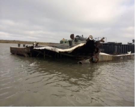 Barge collison damage: Photo courtesy of USCG