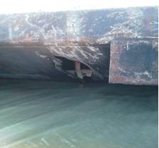 Photos of damage to the barge CBC 7026 and barge TTI-150 after they collided near mile marker 341 in the Intracoastal Waterway, Dec. 23, 2013. U.S. Coast Guard photo.