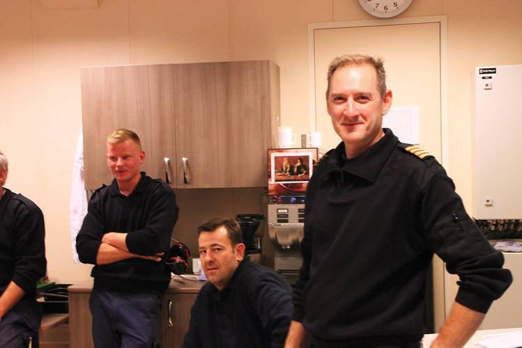 """""""We are very pleased with the  uncomplicated handling of  this advanced propulsion.""""   Chief Engineer John Tolle and his crew in the  engine control room of the RoPax ferry Stavangerfjord."""