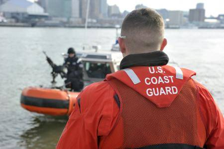 Petty Officer 2nd Class Brad Haines communicates with a maritime safety and security team member during a patrol on the Hudson River. U.S. Coast Guard photo by Petty Officer 3rd Class Michael Himes.